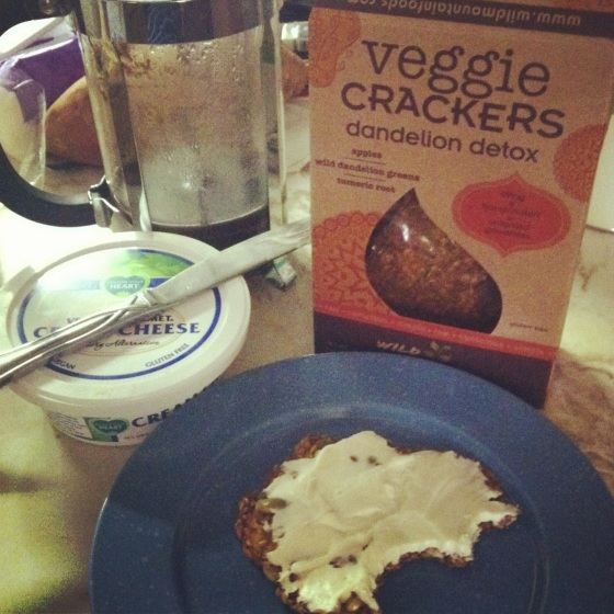 raw vegan dandelion greens crackers with vegan cream cheese spread